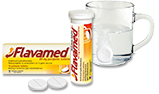 Putojošā tablete šķīst ūdenī blakus iepakojumam ar Flavamed® 60 mg putojošajām tabletēm mitra klepus ārstēšanai